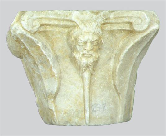Capital with horned head.