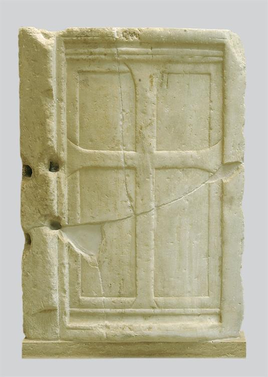 Marble closure slab with a relief cross
